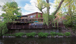 About the Willowtree Inn: view from the creek of the back decks.